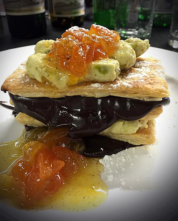 We don't want to spoil the surprise, so we are showing you the dessert you won't be eating on April 23: Orange-Kumquat Marmalade Millefeuille with Dark Chocolate Ganache and Pistachio Mousse.