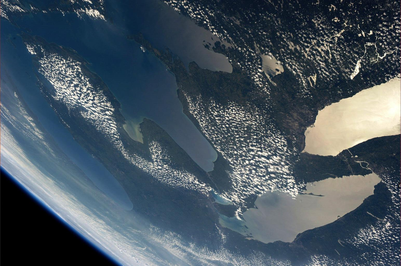The Great Lakes, as viewed by American astronaut Karen L. Nyberg from the International Space Station, 2013. Lake Ontario is the body of water in the upper right. It connects to Lake Erie, below, via the Niagara River.