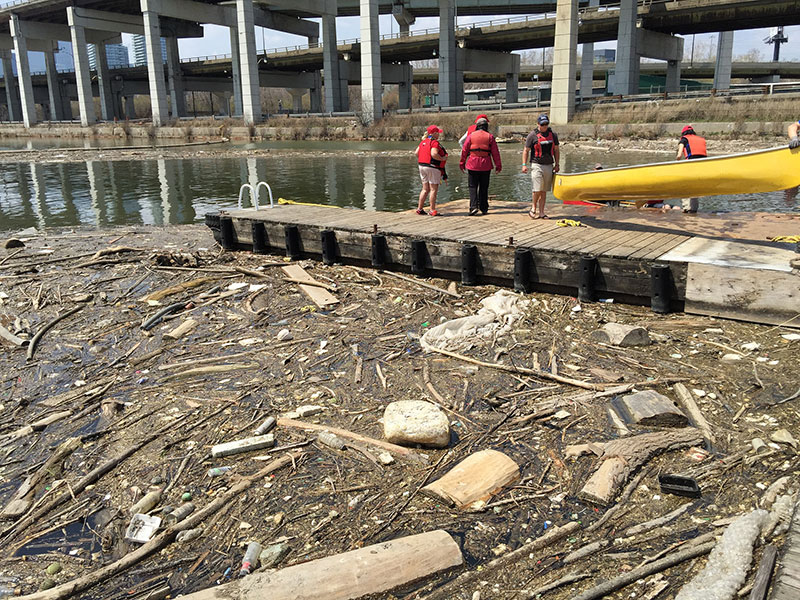 Trash accumulating in the Keating Channel – the landing site for paddlers at the end of the course. (Photo: Lake Ontario Waterkeeper)