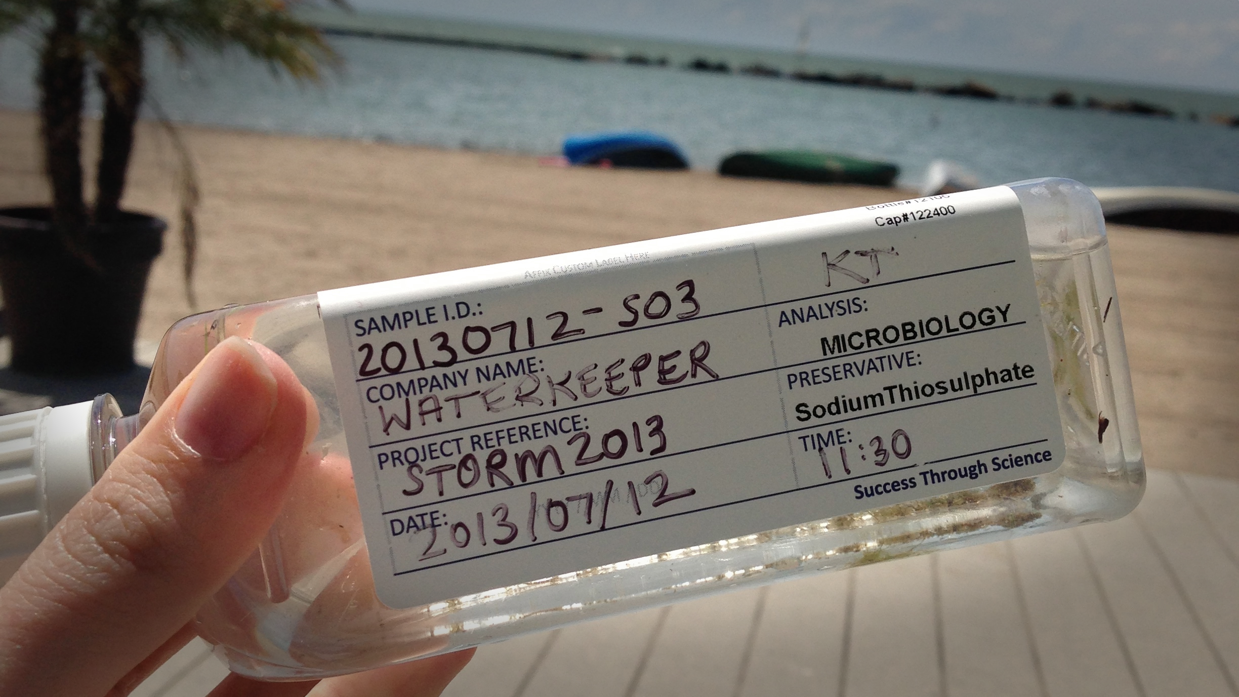 Collecting water quality samples from Sunnyside beach in July, 2013. That summer storm sent bacteria levels sky-rocketing at this popular city swim spot.
