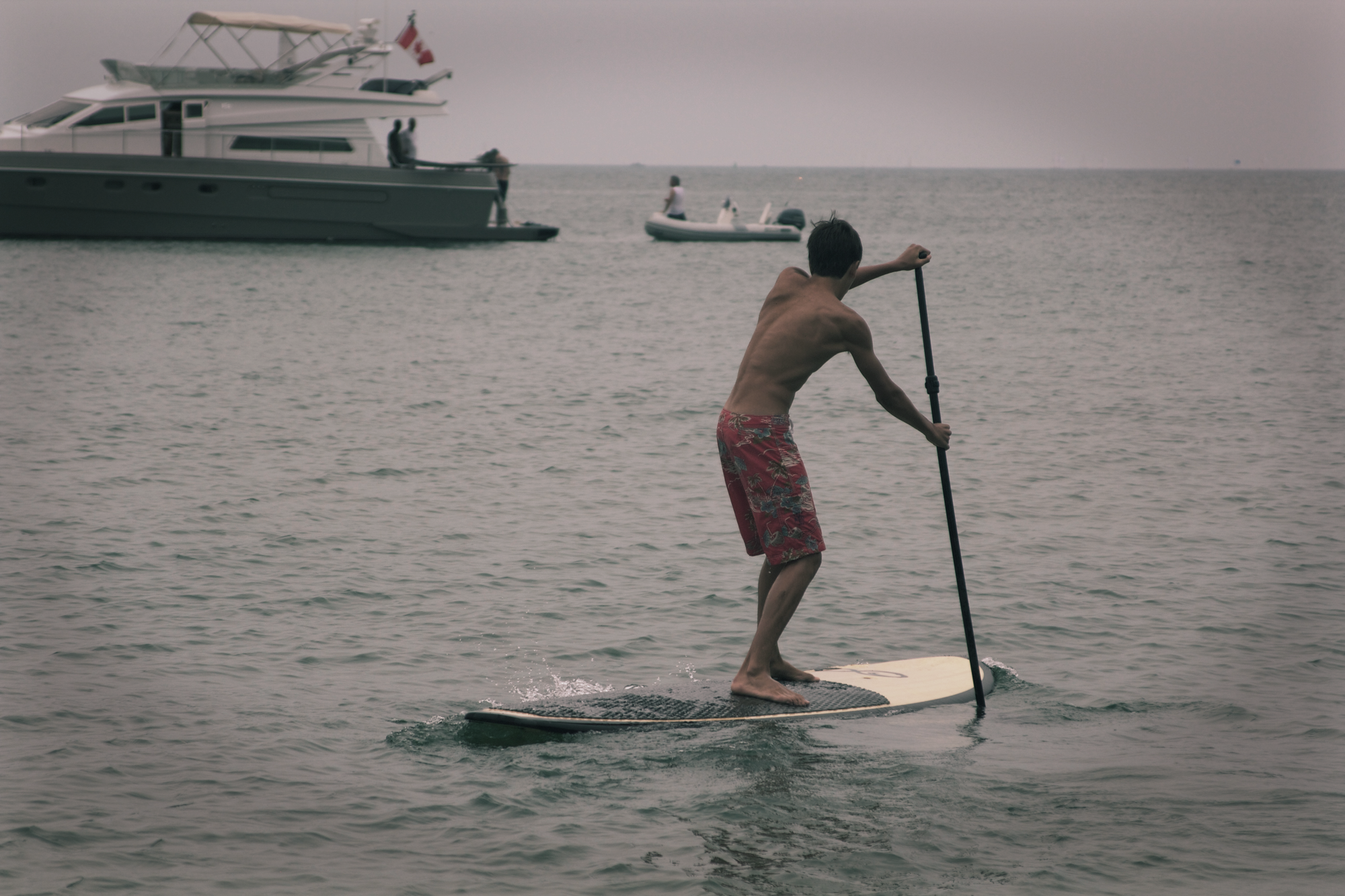 Stand-up-paddleboarding at Ward's Island beach. Summer, 2013. Photo by Dylan Neild.