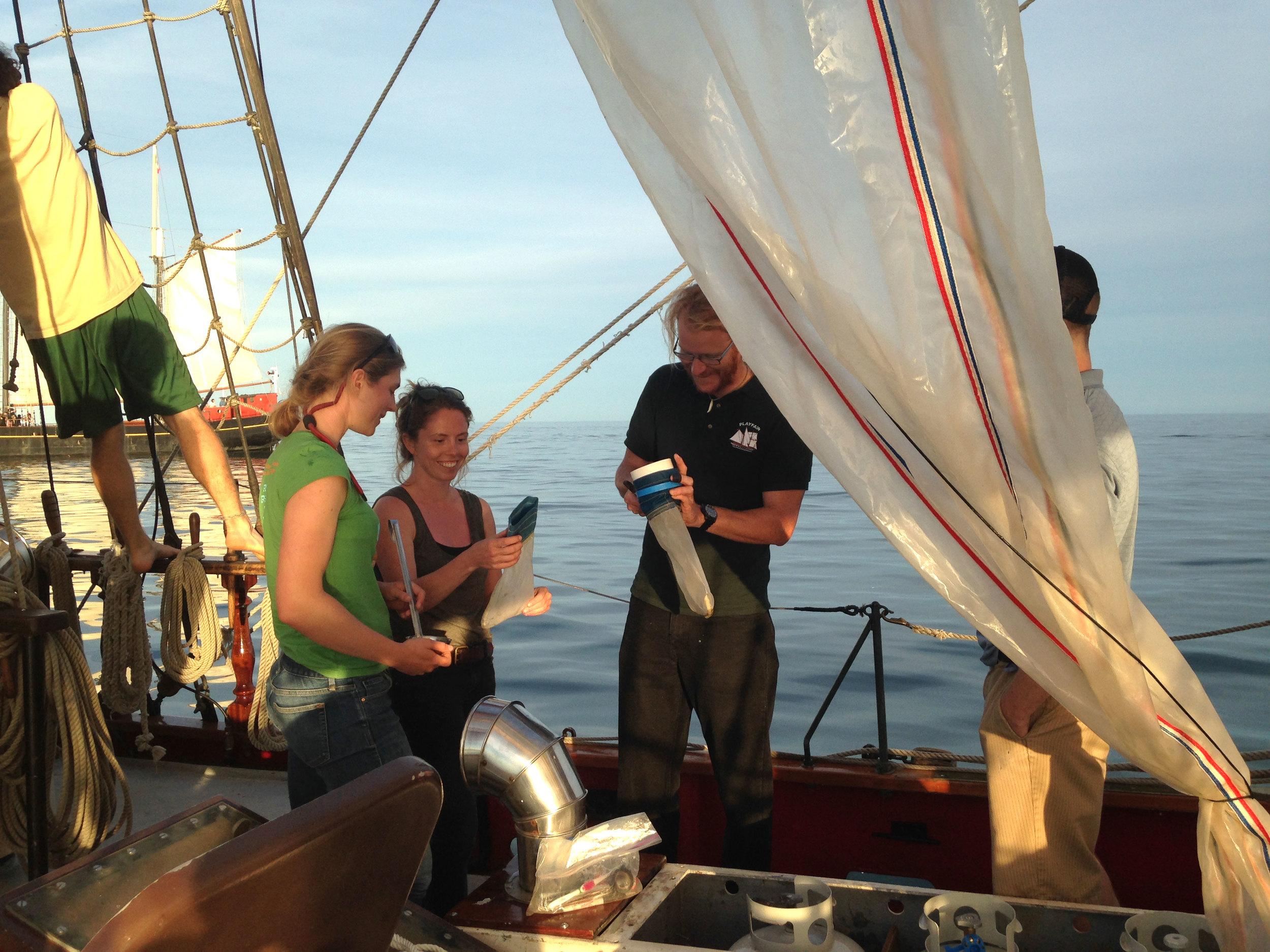 Anika Ballent,Lisa Erdle,andMaster Patrick Shore collecting microplastics in Humber Bay. (Photo via Lake Ontario Waterkeeper)
