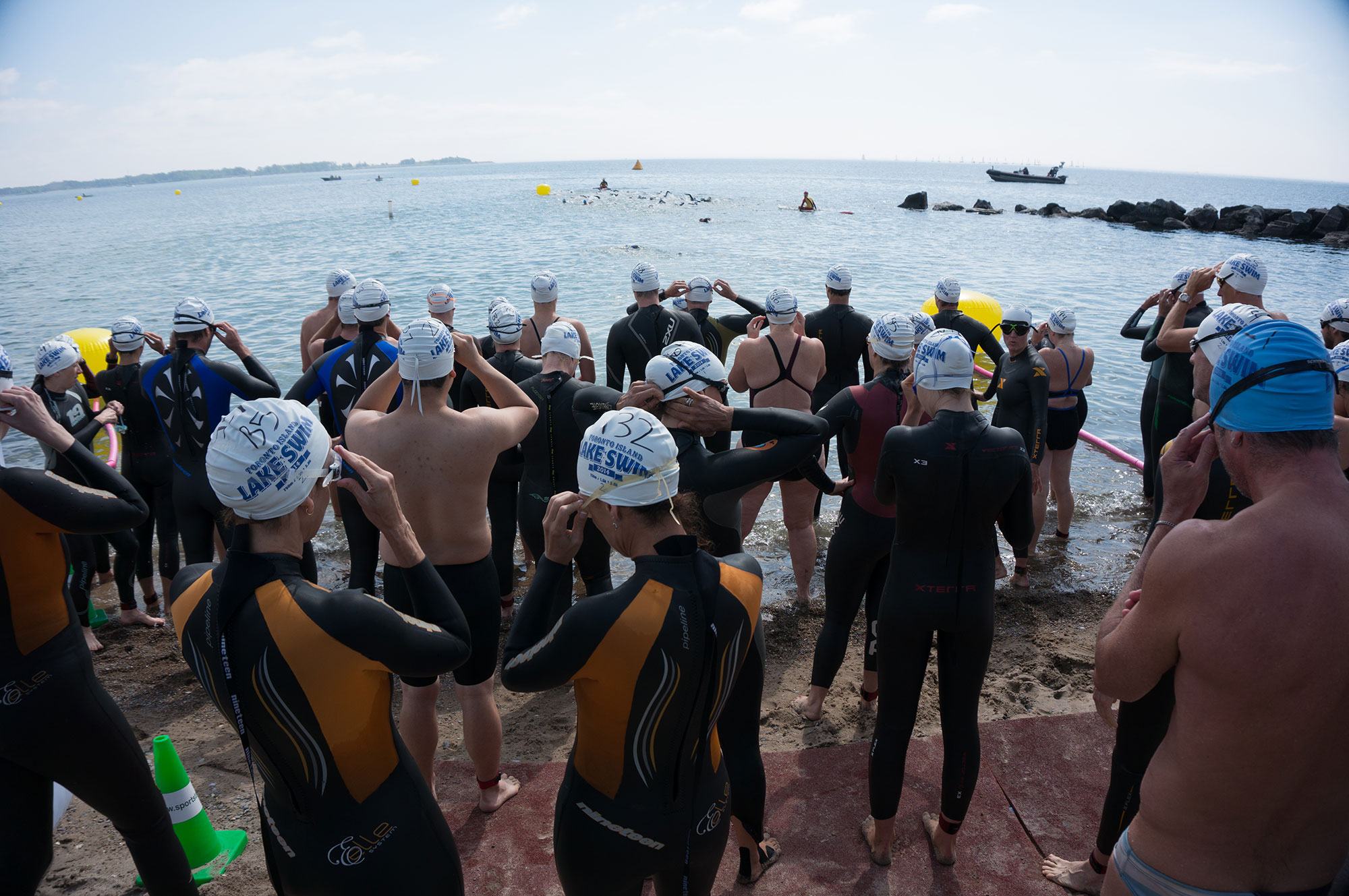 Another wave of swimmers getting ready to take the plunge at last year's Toronto Island Lake Swim. (Photo via Lake Ontario Waterkeeper)