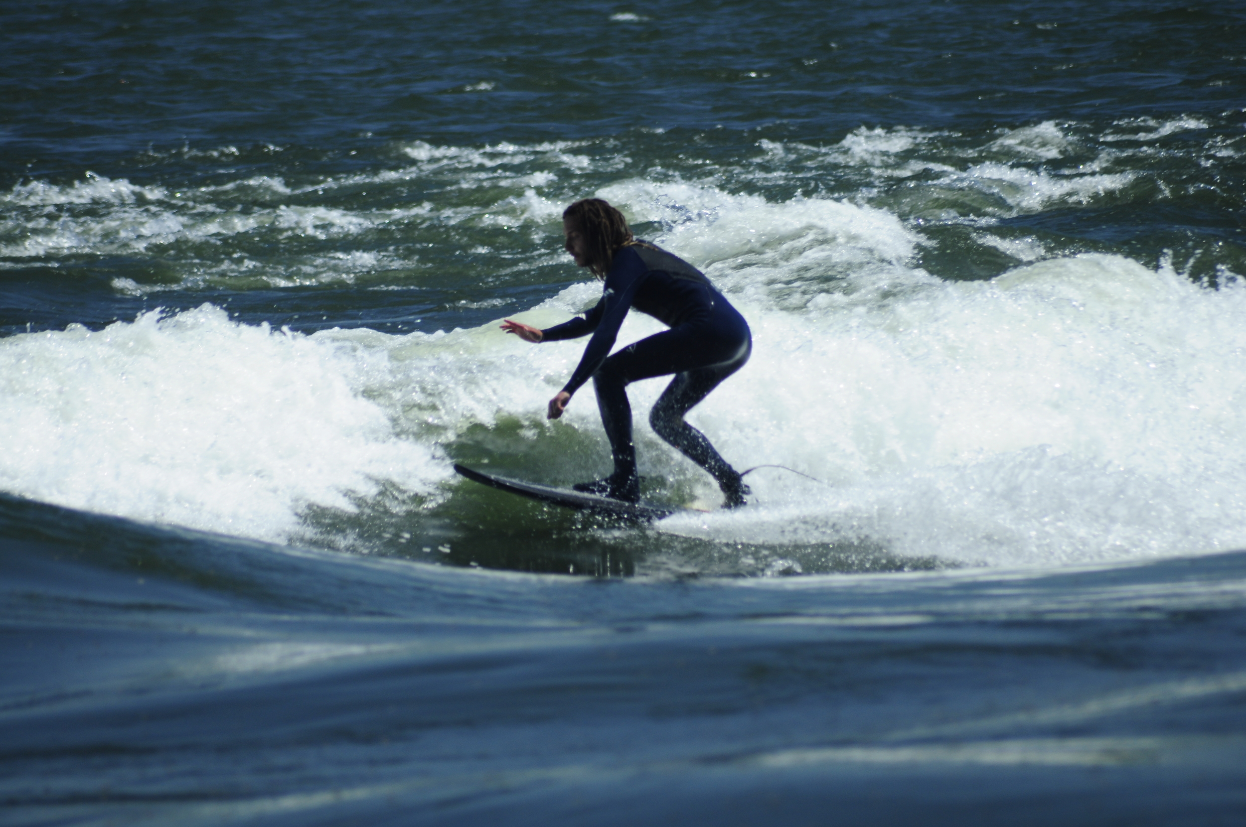 A popular surfing spot in downtown Montreal will be surrounded by sewage release spots if the city goes ahead with its plan to dump 8-billion litres of raw sewage into the river this month. Photo courtesy  Pedro fait de la Photo via Flickr.