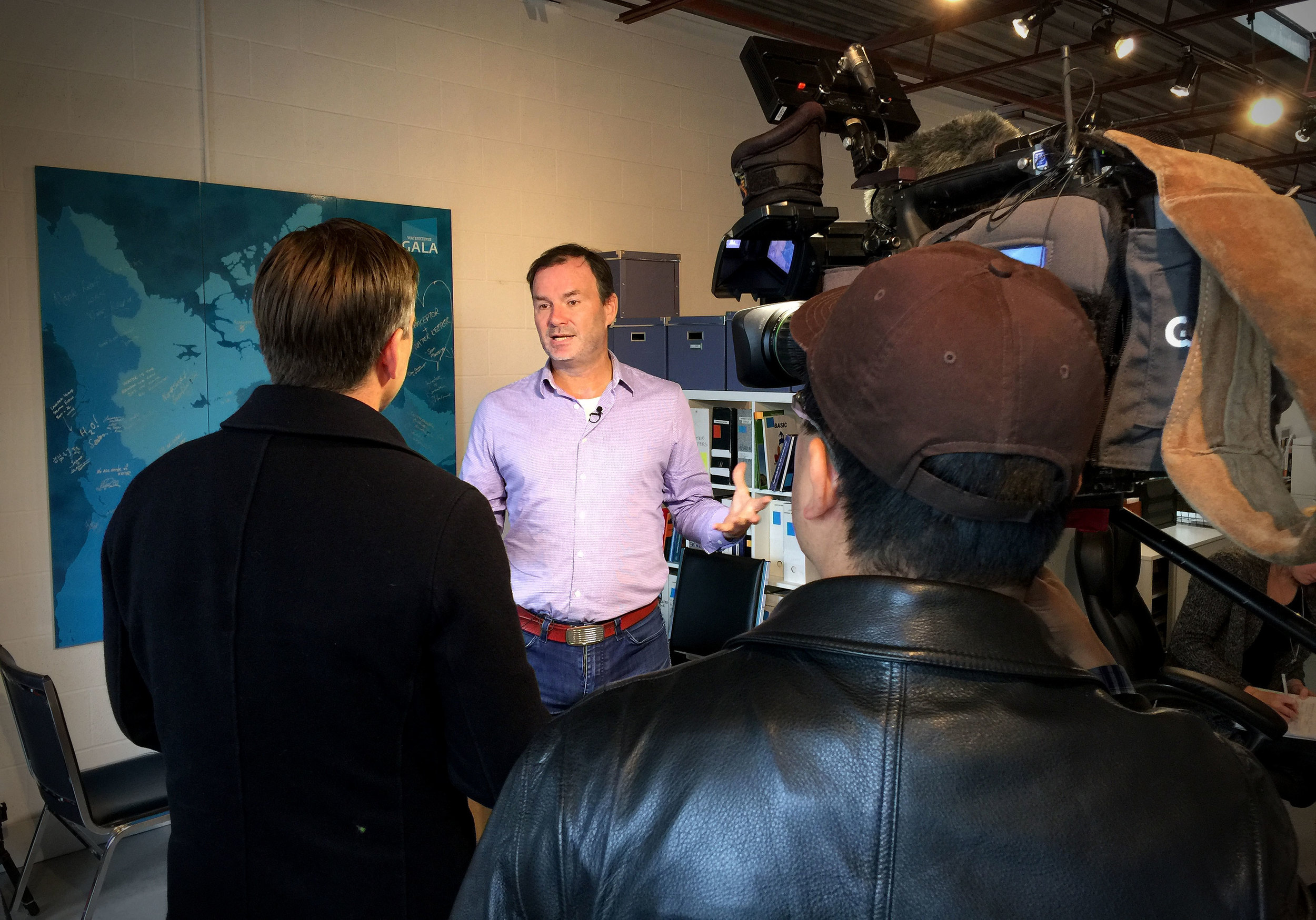 Global News Toronto's Mark McAllister interviewing Waterkeeper Mark Mattson at the Waterkeeper office. (Photo via Lake Ontario Waterkeeper)