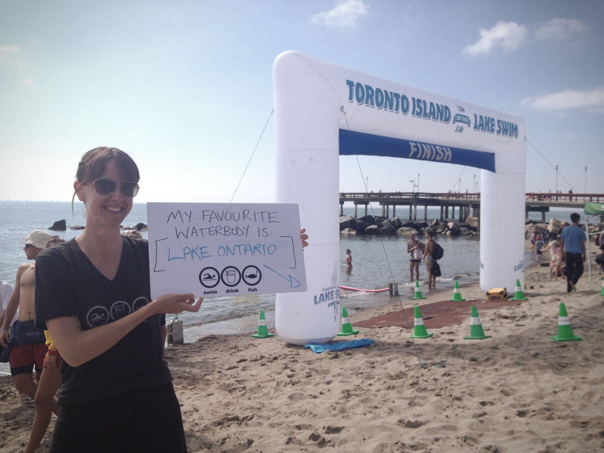 Krystyn showing her love for her favourite waterbody at the 2013 Toronto Island Lake Swim. (Photo via Lake Ontario Waterkeeper)