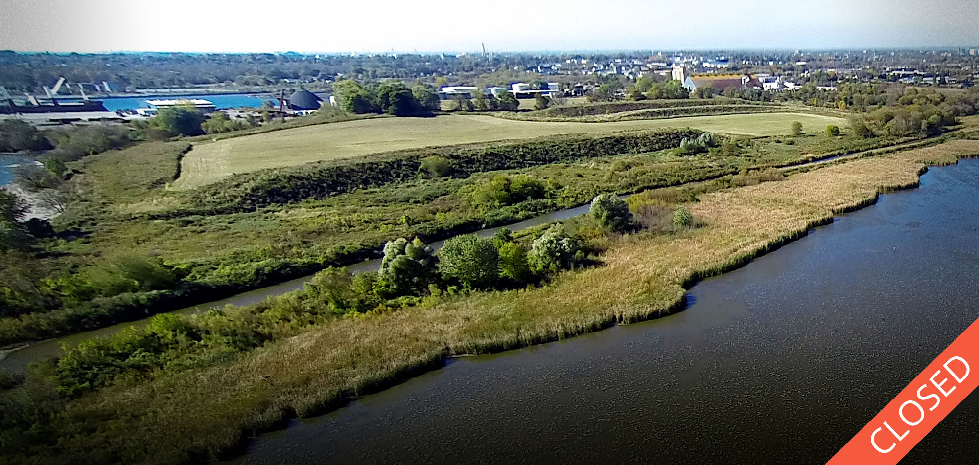 Gifford Hill separates the Port of Oshawa (in the distance) from Second Marsh (in the foreground). Photo by Dylan Neild.