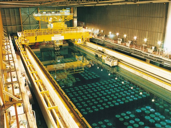 High-level radioactive waste is stored in pools for the first 10 to 20 years after it's used to keep it cool. (Photo via  World Nuclear Association )