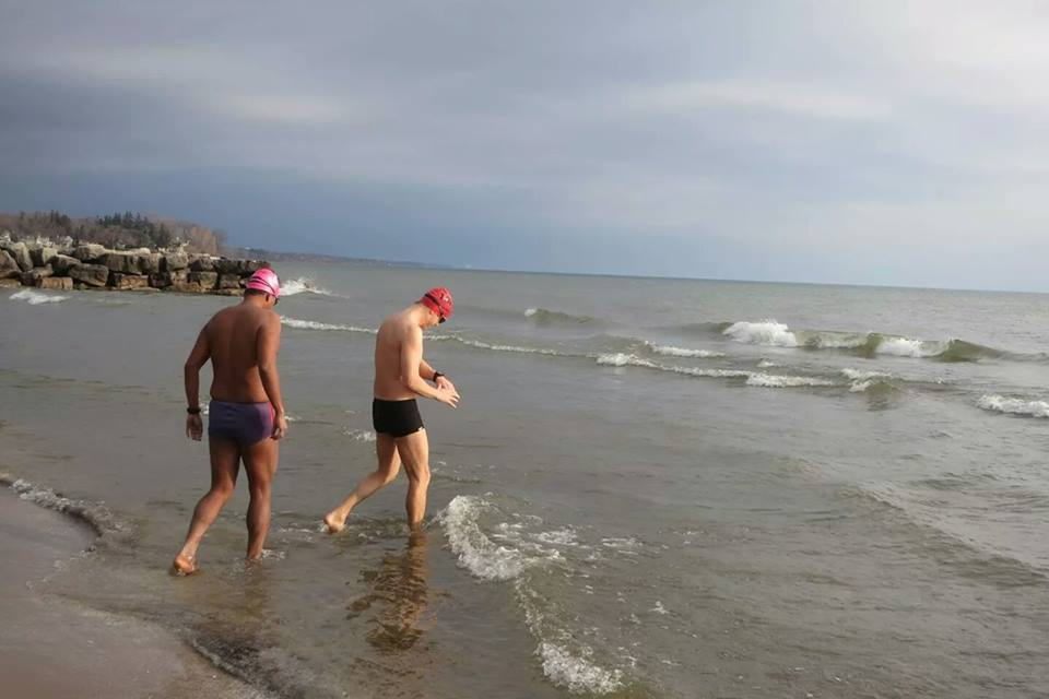 Open water swimmer, Loren King training in early spring. (Image via  Great Lakes Trust )