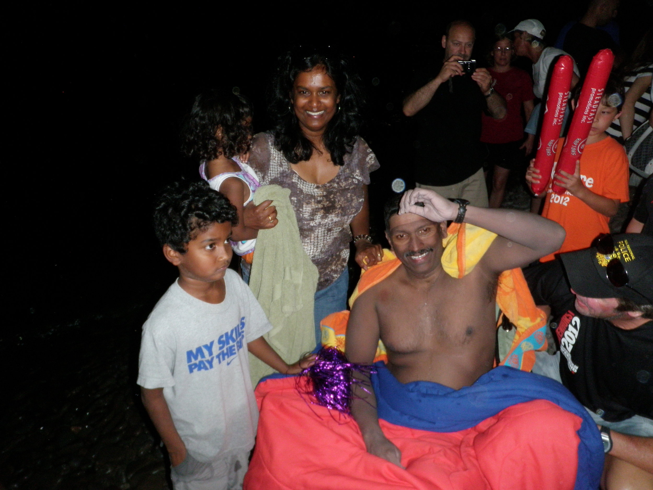 Madhu with his family after his epic swim across Lake Ontario. (Photo via  L.O.S.T. Swimming )