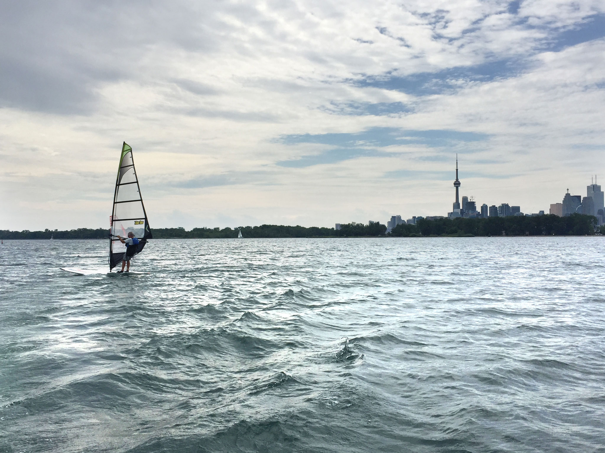 Windsurfer looking for speed outside of the Eastern Channel. (Photo by Lake Ontario Waterkeeper)