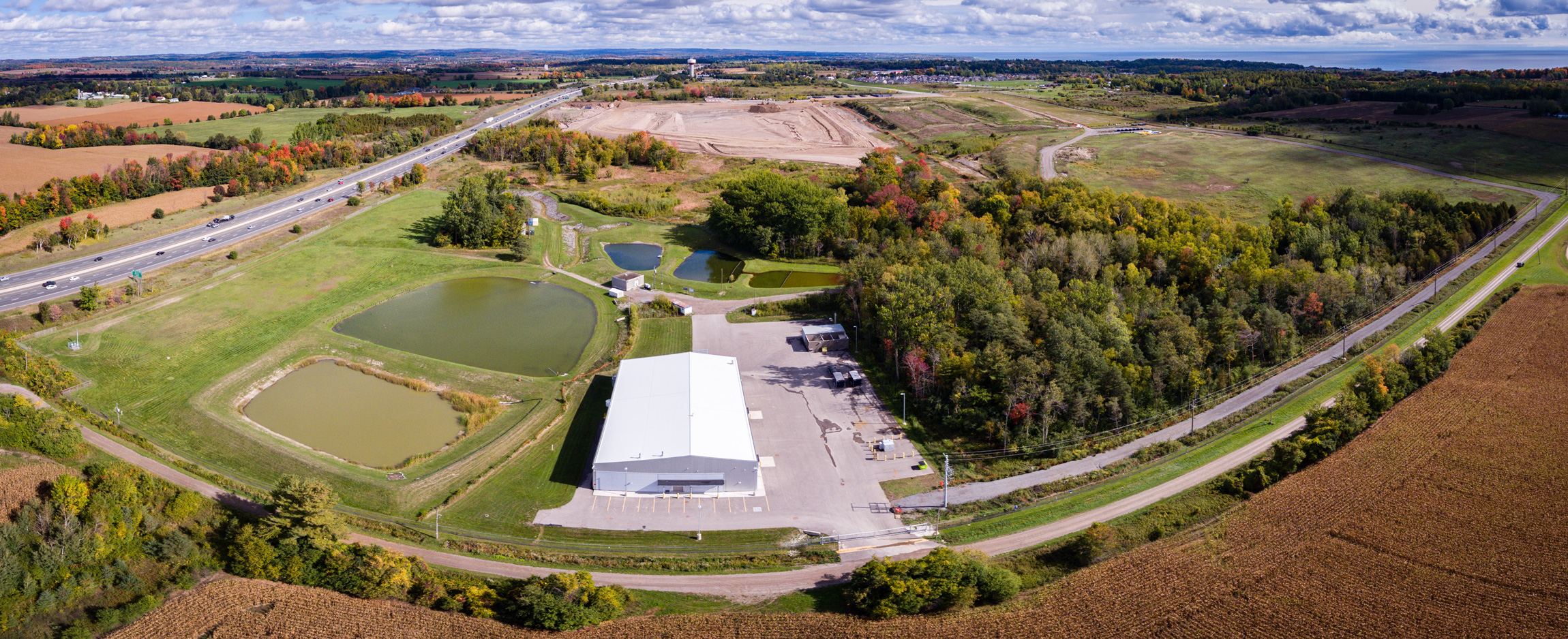 The water treatment facility with the long-term storage site in the background. (Photo by Dylan Neild)