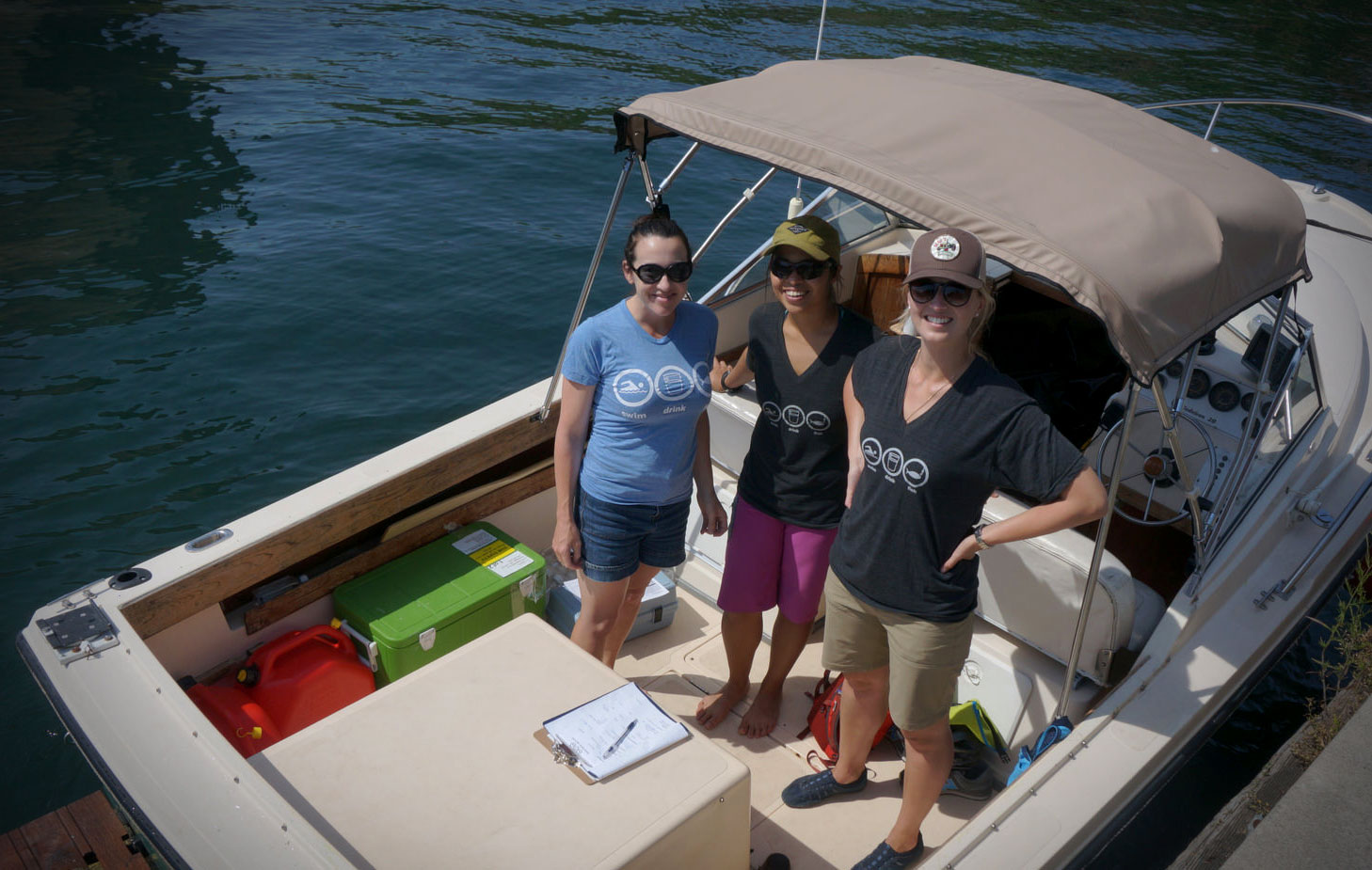 Waterkeeper's team wearing their Swim Drink Fish circles with pride while collecting water samples from Toronto's harbour this past summer. (Photo by Li Black)