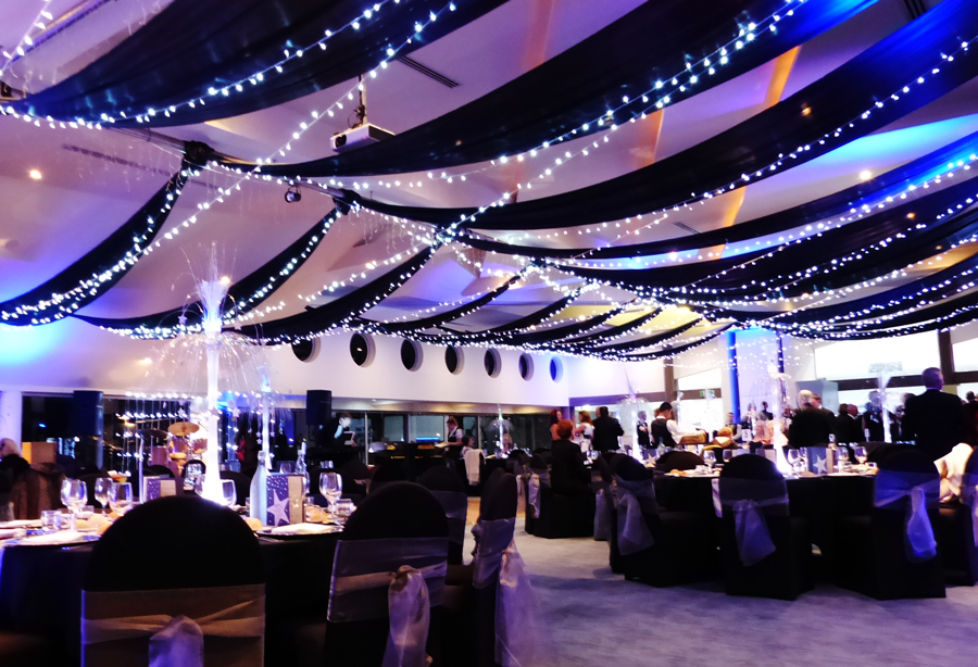 Black fabrics, white light fairy lights & blue up lighting.