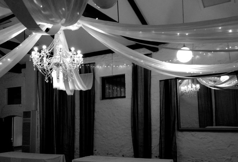 White ceiling canopy with large chandelier.
