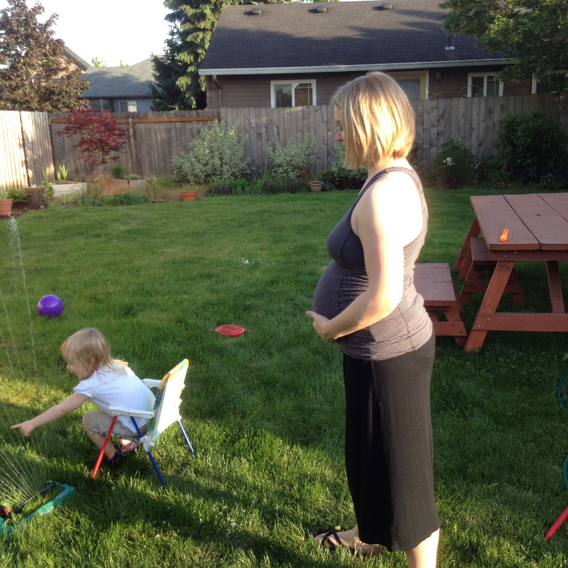 Backyard fun - this girl loves the sprinkler, and I love watching her