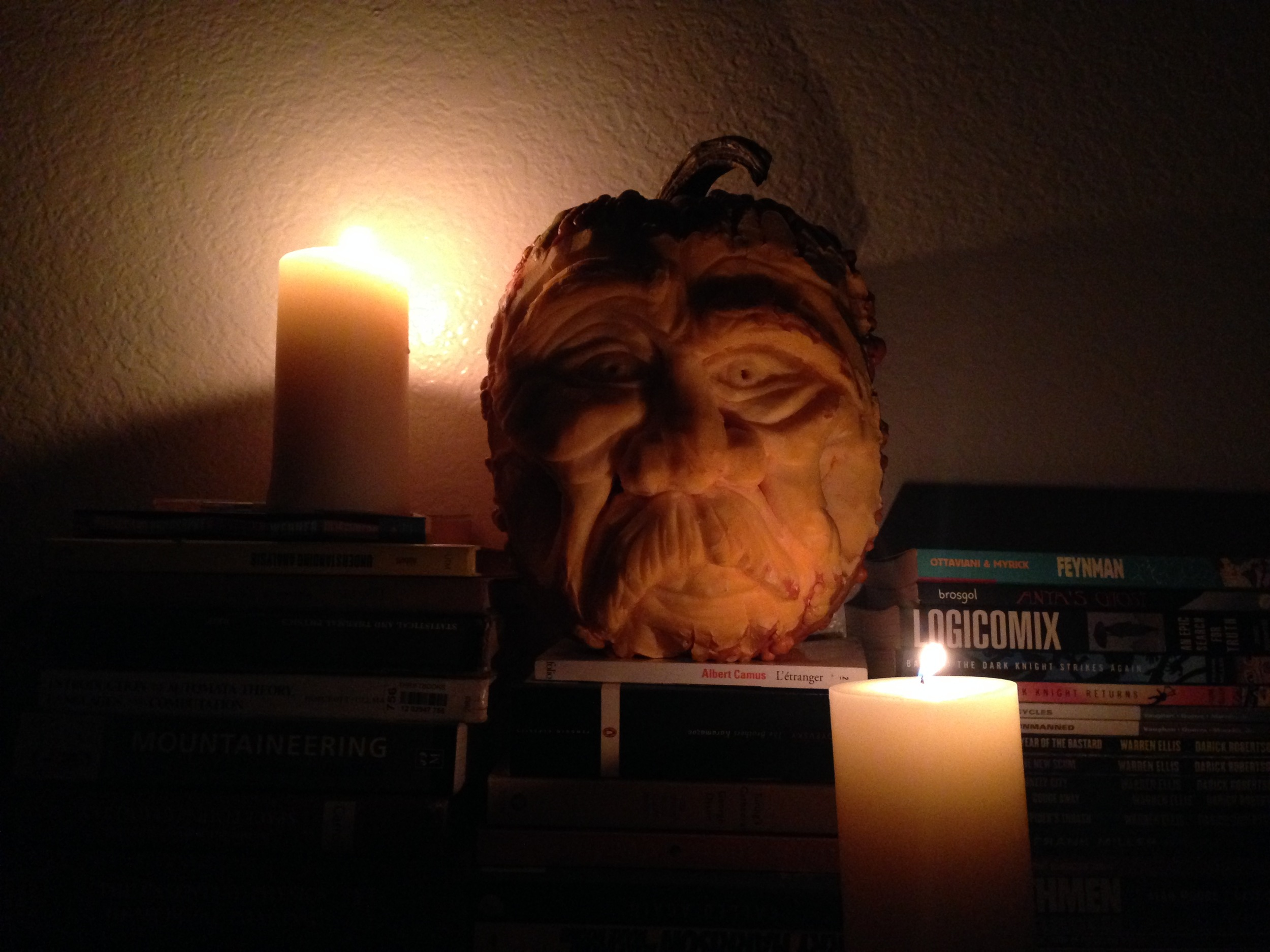 Mortimer lit by two candles. Look at that old wrinkly face and big ole mustache.