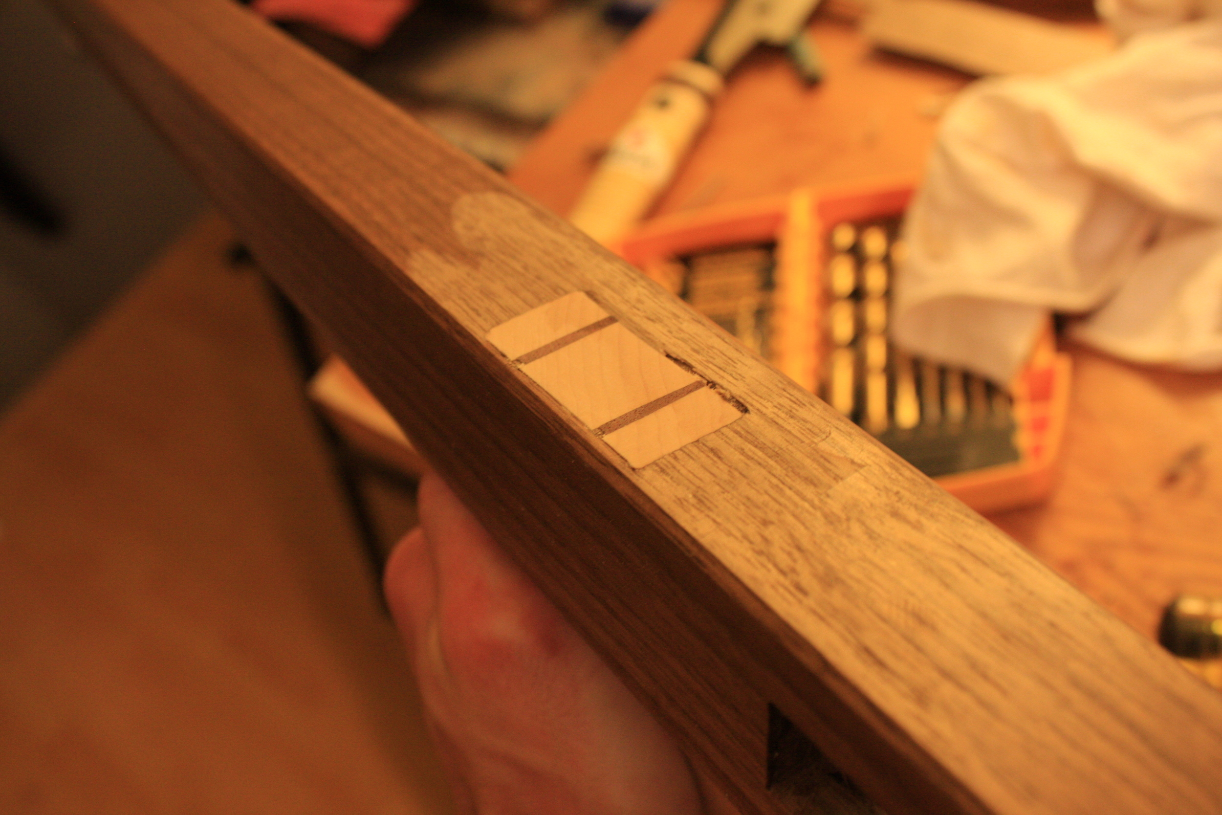 Post gluing and planing wedged joint. The little bit of damage to the finish was non-trivial but not a big deal in the end.