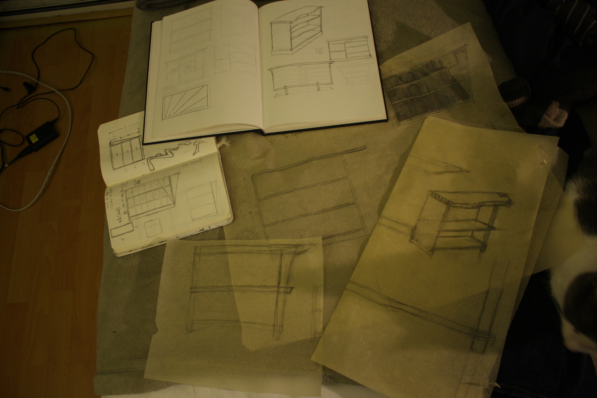 """Initial drawings of the bookshelf. The picture in the moleskine was my """"finished"""" design. See any resemblance between that and the finished product? Yeah, neither do I..."""