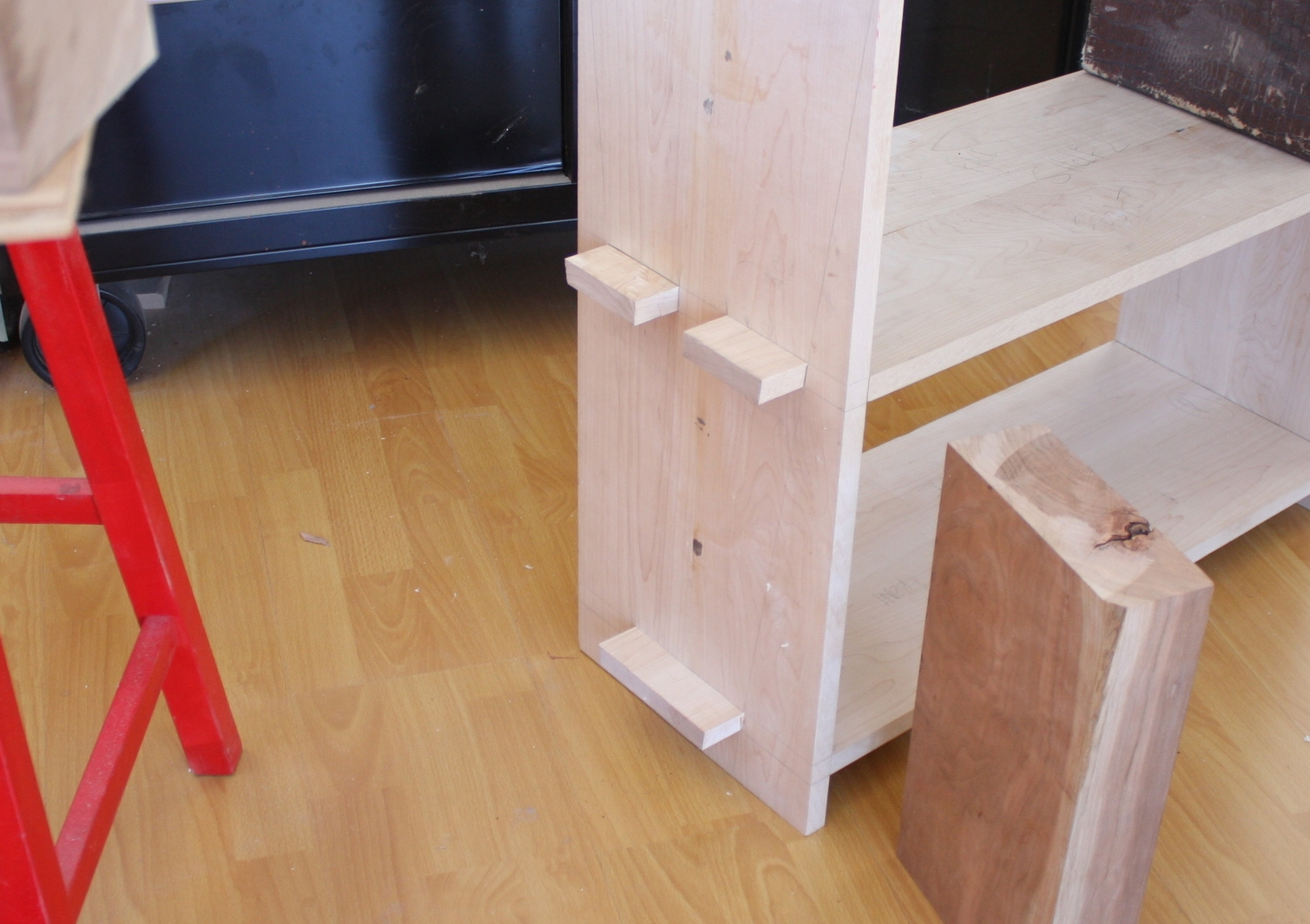 Angled sides on the through-mortises.