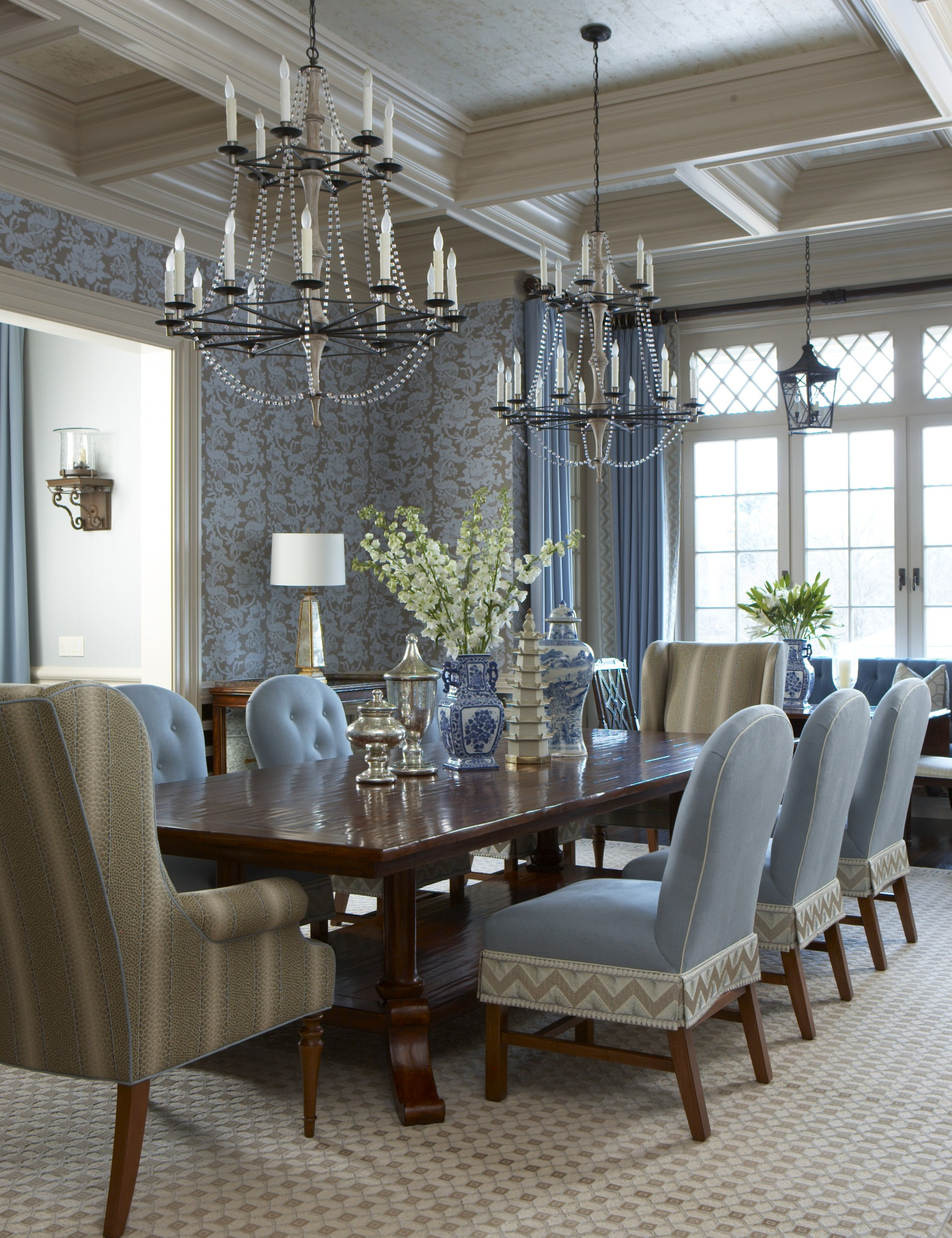 Two chandeliers help to fill the grand size of the dining room and are more relaxed than one very dominant light fixture. Photo by Michael Partenio.
