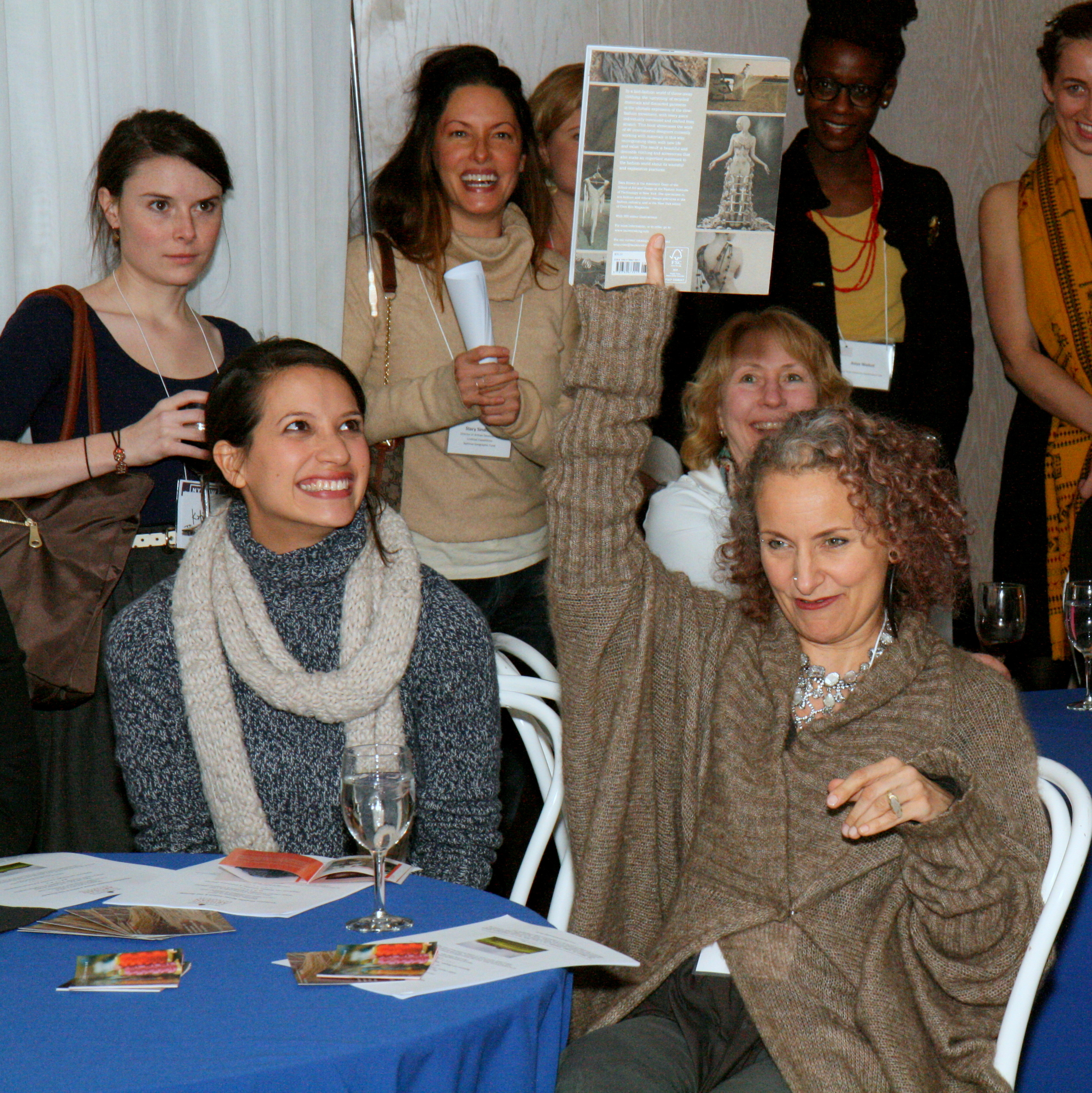 Sass Brown proudly raises the copy of her forthcoming book Refashioned