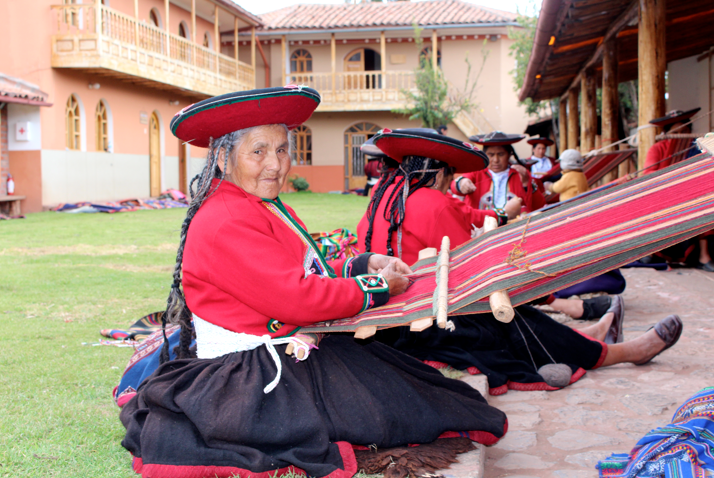 A CTTC weaver using her back strap loom.