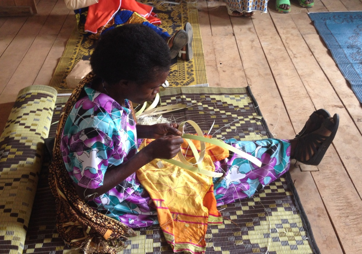 A weaver demonstrates the initial phase of creating a basket