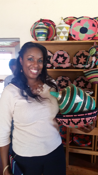 Director of Global Programs, Natika Washington purchasing baskets made by Bugersera women basket weavers.