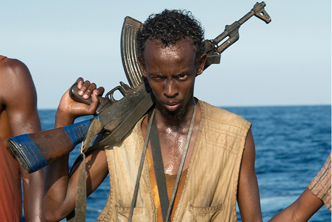 PHOTO CREDIT: Above is a production still from  Captain Phillips  featuring actor Barkhad Abdi as Muse, the leader of the Somali pirates.