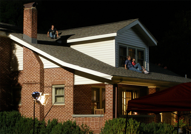 "PHOTO CREDIT:  Above image is a behind-the-scene photo of Space Warriors - photographed by Jerry .  The photographer describes the photo as follows: ""Much of Space Warriors was shot at the Space & Rocket Center, but scenes of the teenager's home life were shot at this house. For this shot, he and his father are on the roof of the house, watching for the International Space Station to fly over."""