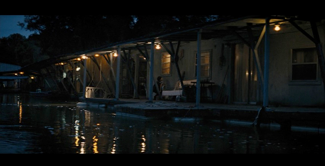 PHOTO CREDIT: Above is a screenshot of Ellis as he looks into the houseboat where he's living with his parents.