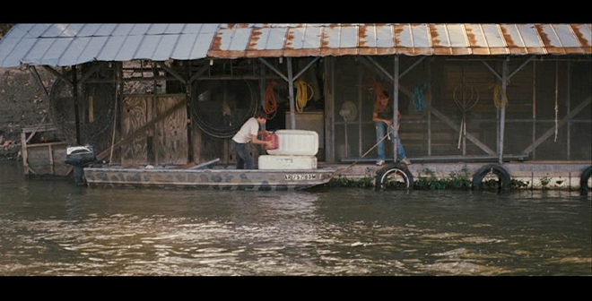 PHOTO CREDIT: Screenshot of Ellis and Neckbone as they gather materials in front of Ellis's houseboat.