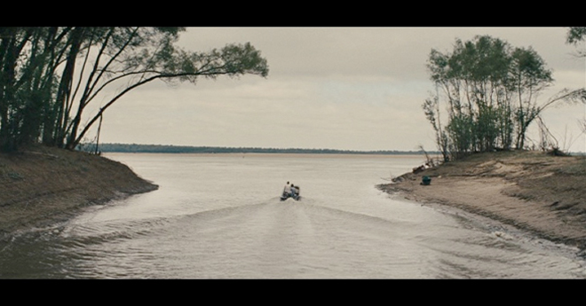 PHOTO CREDIT: Screenshot of Ellis and Neckbone riding their boat down a channel toward the open Mississippi River.