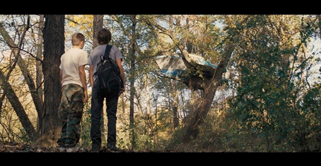 PHOTO CREDIT: Above is a screenshot of Ellis and Neckbone looking up at Mud's boat-in-a-tree house.