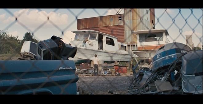 PHOTO CREDIT: Above is a screenshot of Ellis and Neckbone at the junkyard gathering materials to help Mud getaway.