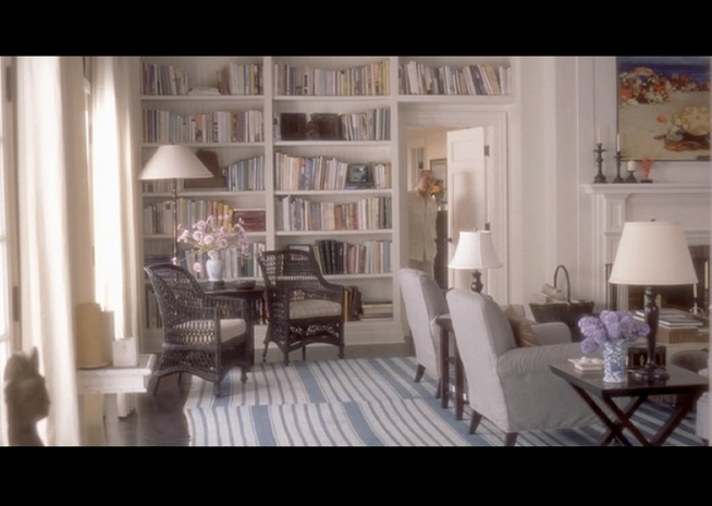 PHOTO CREDITS:  Above are screenshots of two scenes (both with Harry) taken place at Erica's beach house showcasing the beautiful bookshelves with books shipped from the Strand bookstore in New York City.