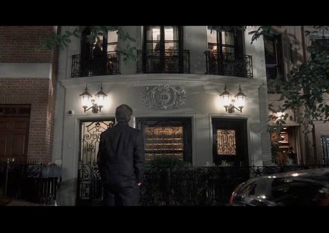 PHOTO CREDIT:  Above photo is a screenshot from the movie of Harry standing in front of his New York townhouse.