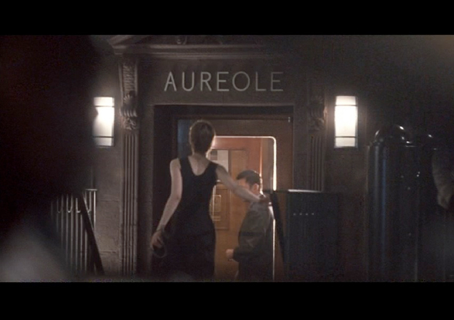 PHOTO CREDIT:  Above is a screenshot from the movie's opening sequence where we see beautiful young women walking on the sidewalks of New York. This scene of a lady is entering Aureole Restaurant was filmed on location in front of the real Aureole.