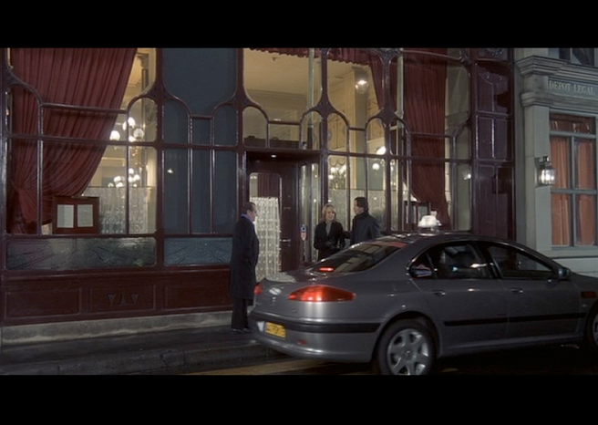 PHOTO CREDITS:  Above are screenshots from a scene filmed in front of the Grand Colbert in Paris.