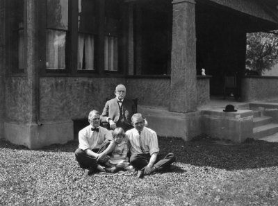 Photo above of Paris Gibson, his son, grandson and granddaughter in front of the Gibson House - courtesy of Kelly Parks.