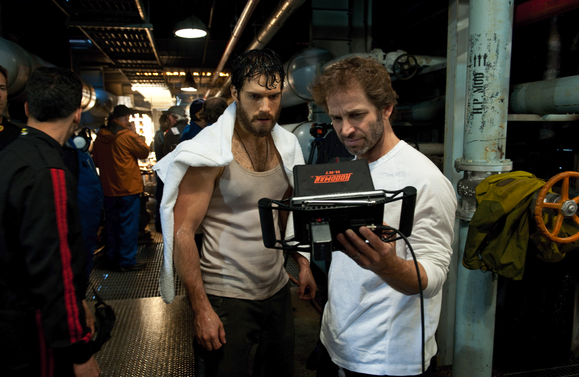 Director Zack Snyder and  Henry Cavill (Clark Kent/Superman) on the set of  Man of Steel  (filmed in California, Canada and Illinois) - image via  Google .