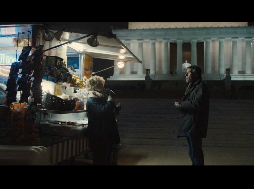 Screenshot: Martin and Philomena in a deep conversation in front of the Lincoln Memorial. The hot dog stand and the Monument in the background provided enough crucial and ambient lighting for the entire frame.