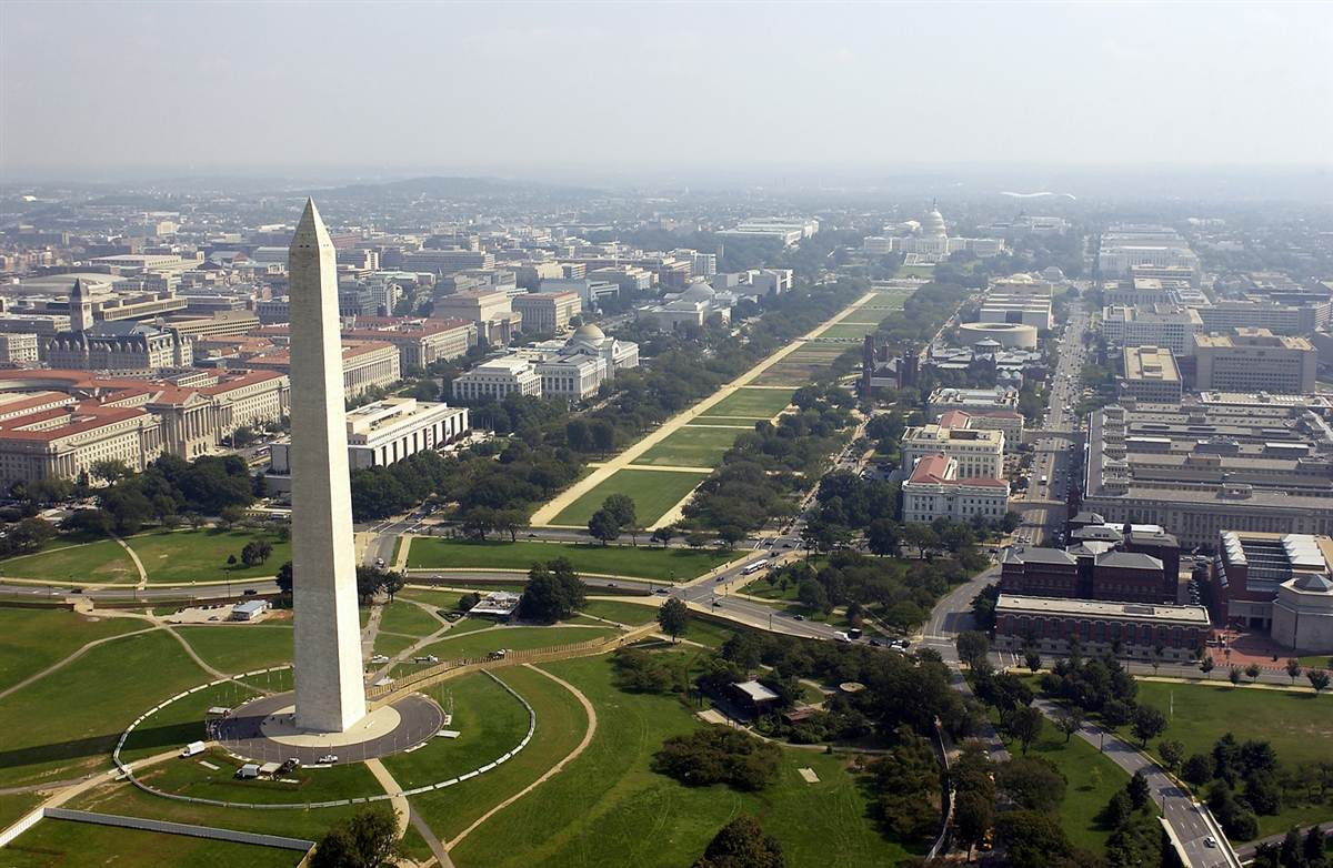 An aerial view of the National Mall flanked on each side by the Washington Monument and the U.S. Capitol - image via  Google .
