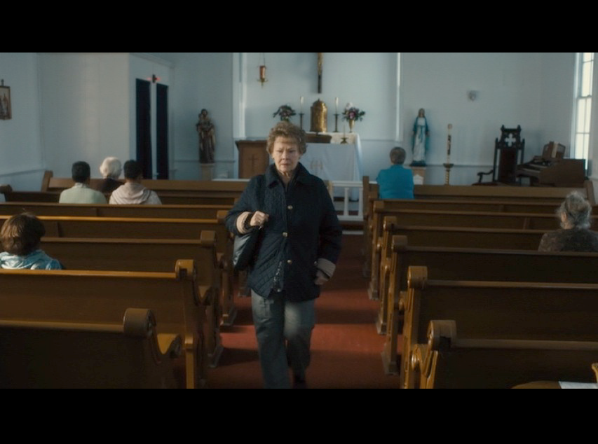 Screenshot: Philomena leaving St. Anthony's Catholic Church. For the movie, the production team added the congressional boxes on both sides of the church's interior.