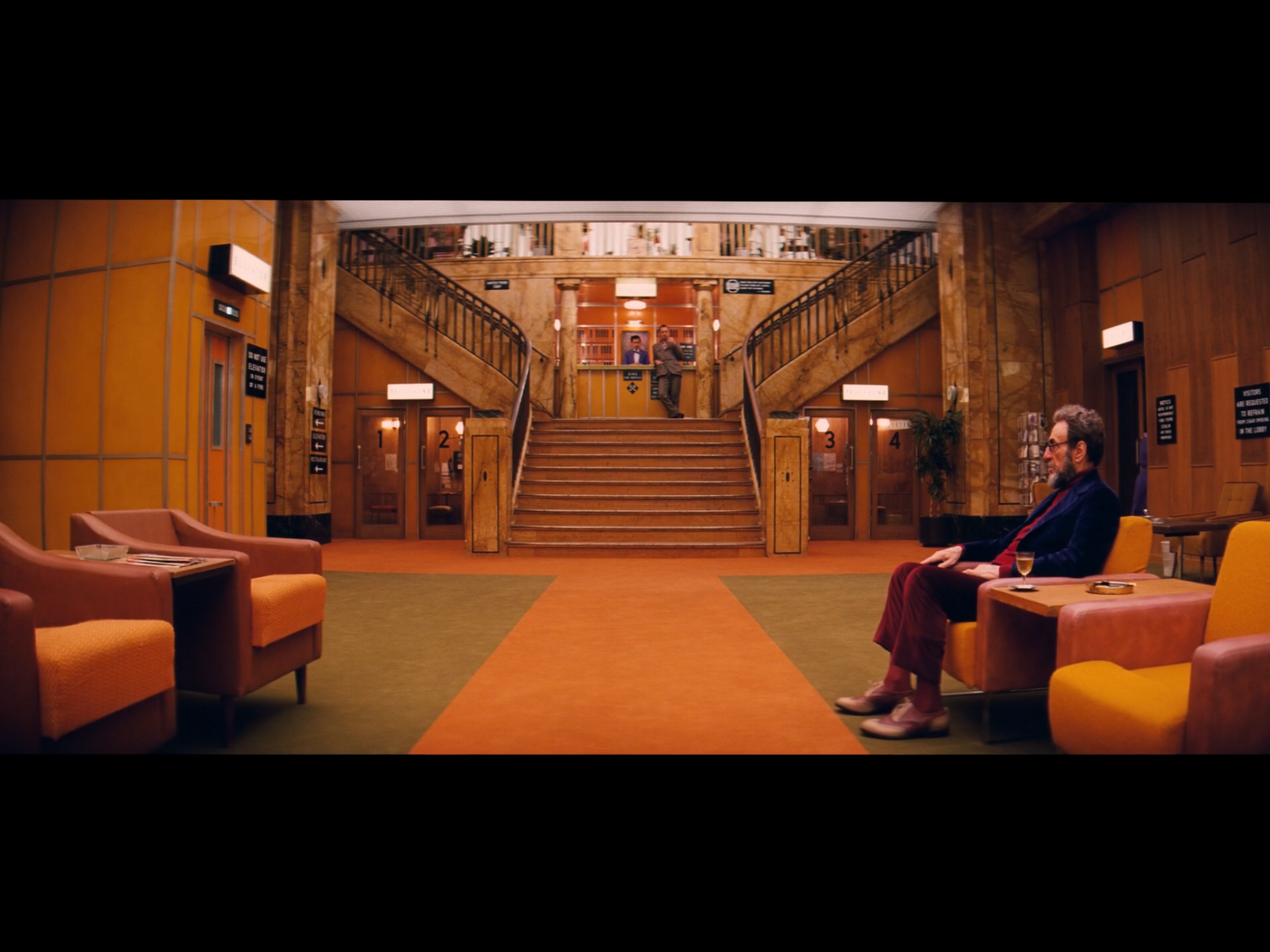Screenshot of the young Author's first glimpse of the elderly Zero in the Grand Budapest Hotel lobby (in the 1960s). The film location of the above scenes was the Görlitz Warenhaus Department Store.