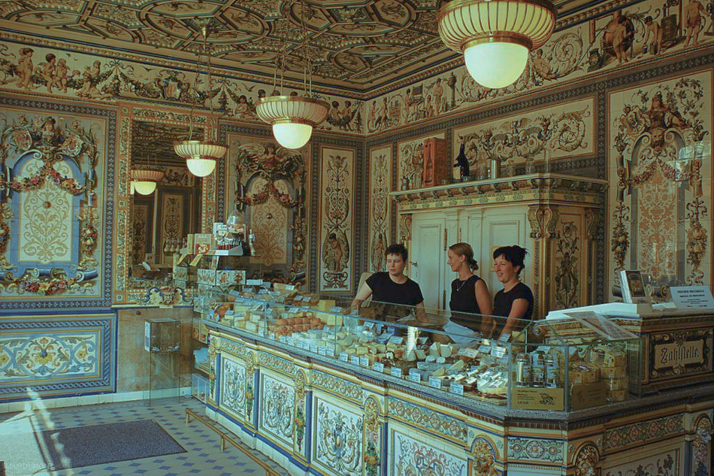 The film location for Mendl's is the real-life famous bakery shop of Pfunds Molkerei, a 19th Century creamery in Dresden. Image via  Google .