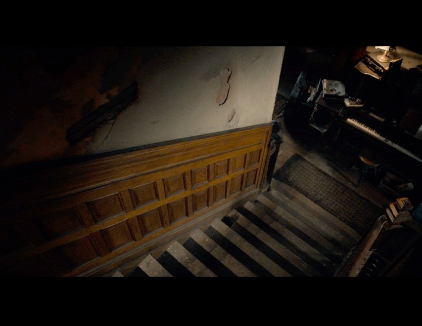 Screenshot from the movie of a stairway scene.