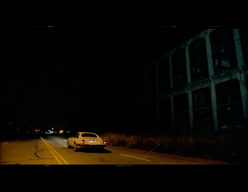 Screenshot from the movie as Adam and Eve drive around the city, passing by Detroit landmarks such as the abandoned Packard Plant.