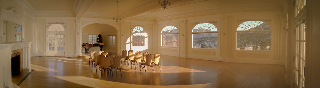 The Music Room at the Stanley Hotel - where guests sometimes hear piano playing even though no one is sitting at the piano. Image via  Google .